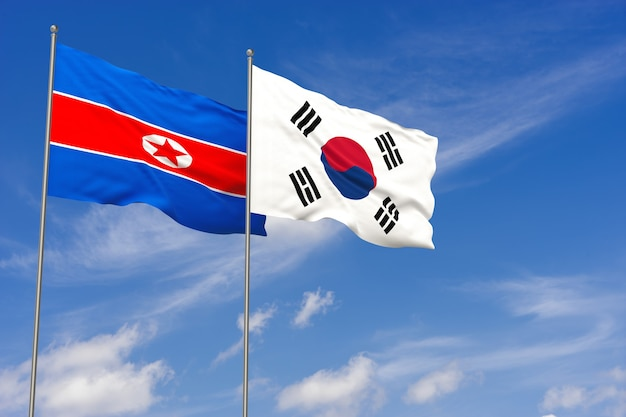 Dwie realistyczne machające flagi narodowe korei południowej i korei północnej. macha na tle błękitnego nieba. ilustracja 3d