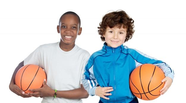 Dwoje uroczych dzieci z piłkami