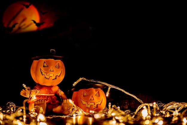 Dynia halloweenowa z nietoperzem i pełnią księżyca