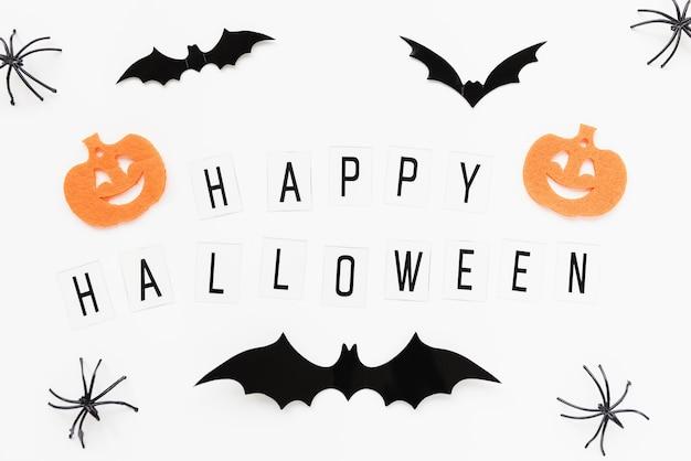 Dynie pająki nietoperze i tekst happy alloween na białym tle halloween płaski układ
