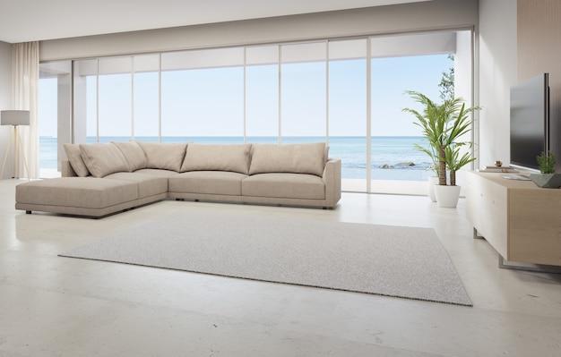 Dywan na trawertynowej podłodze dużego salonu i kanapa obok telewizora w nowoczesnym domu na plaży