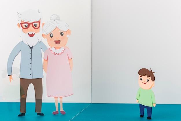 Dziadkowie z dzieckiem w papierze