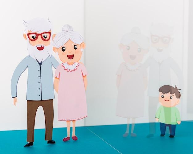 Dziadkowie z dzieckiem za szklaną ścianą