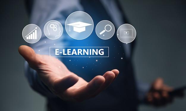 """Działalności człowieka posiadającego telefon i ikonę """"e-learning"""""""