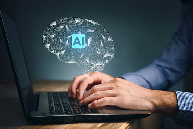 Działalności człowieka pracującego w komputerze z ikonami ai