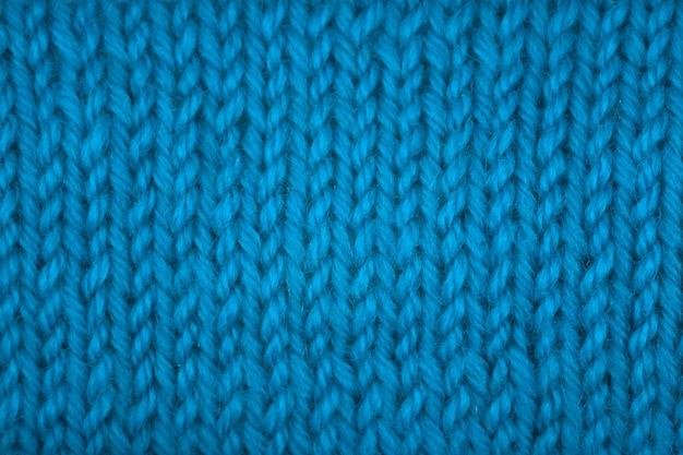Dzianinowa tekstura, przednia powierzchnia. naturalna wełna, klasyczny niebieski, monochromatyczny. zbliżenie, tło