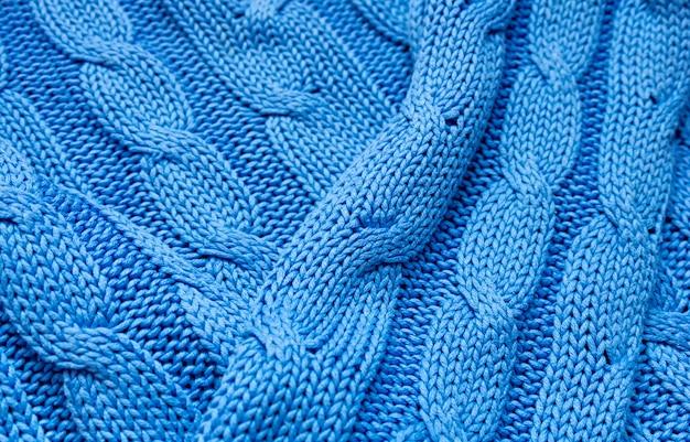 Dzianinowa tekstura w kolorze niebieskim