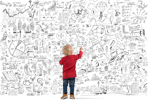 Dzieci rysują na tablicy diagramy i statystyki