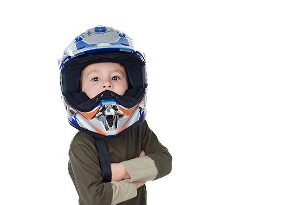 Dziecko Patrzeje Kamerę Z Motocyklu Hełmem Premium Zdjęcia