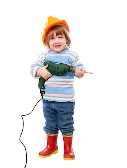 Dziecko w hardhat z wiertłem