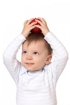 Dziecko z czerwonym jabłkiem