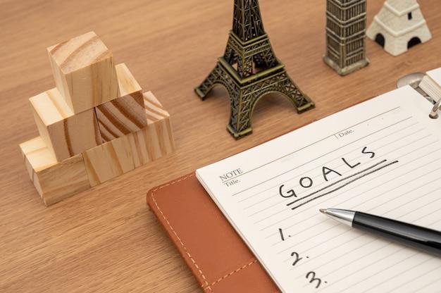 Dziennik i tło koncepcji biznesowej z listą celów