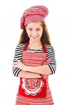 Dziewczyna w czerwonym fartuchu i rękawicy do pieczenia