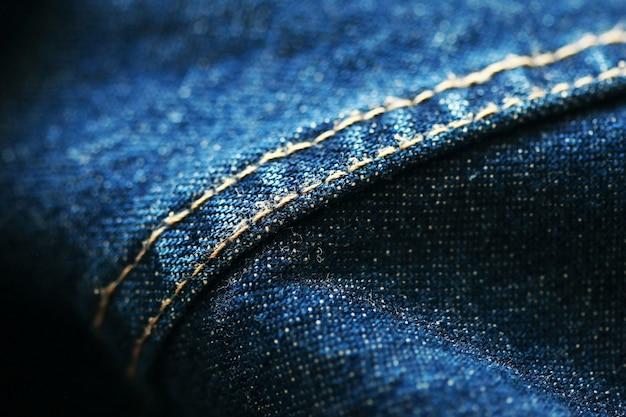 Dżinsy dżinsowe tekstury z bliska, skup się tylko na jednym punkcie