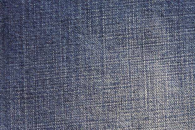 Dżinsy tekstura stary drelichowy tło.
