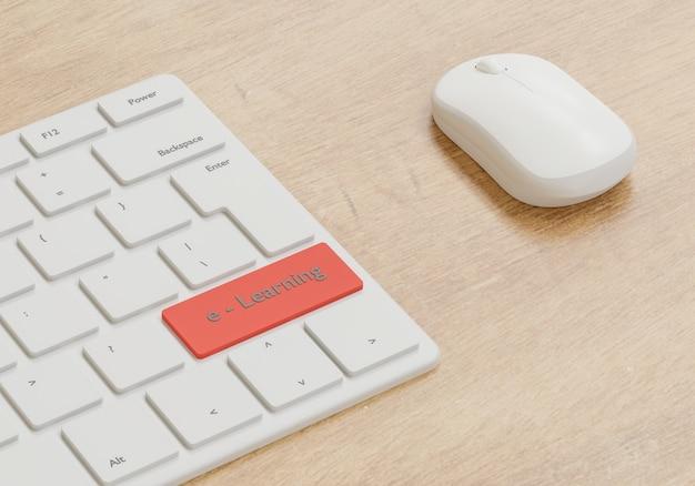 E - koncepcja uczenia się, mysz i klawiatura na drewnianym stole, szkoła online z renderowaniem 3d