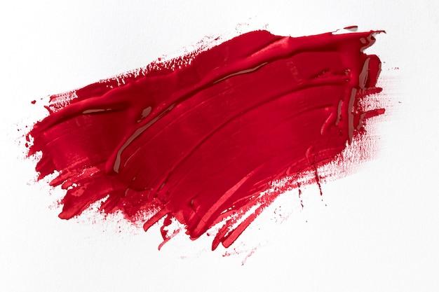 Efekt pociągnięcia pędzlem w kolorze czerwonym