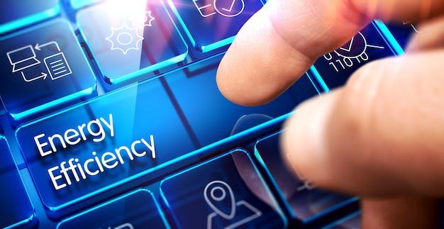 Efektywność energetyczna - napis na przezroczystym klawiszu niebieskiej klawiatury. 3d.