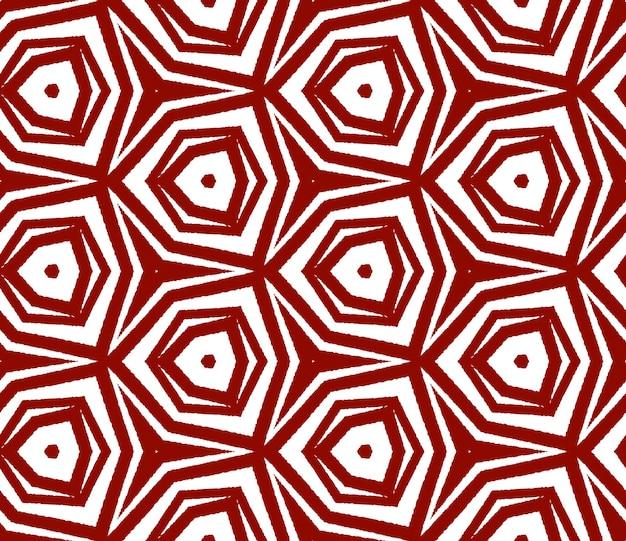Egzotyczny wzór. bordowe symetryczne tło kalejdoskop. letnie stroje kąpielowe egzotyczny wzór bez szwu. tekstylny popularny nadruk, tkanina na stroje kąpielowe, tapeta, opakowanie.
