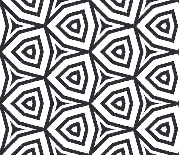 Egzotyczny wzór. czarne tło symetryczne kalejdoskop. tekstylny rzadki nadruk, tkanina na stroje kąpielowe, tapeta, opakowanie. letnie stroje kąpielowe egzotyczny wzór bez szwu.