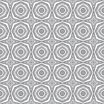 Egzotyczny wzór. czarne tło symetryczne kalejdoskop. tekstylny zapierający dech w piersiach nadruk, materiał na stroje kąpielowe, tapeta, opakowanie. letnie stroje kąpielowe egzotyczny wzór bez szwu.