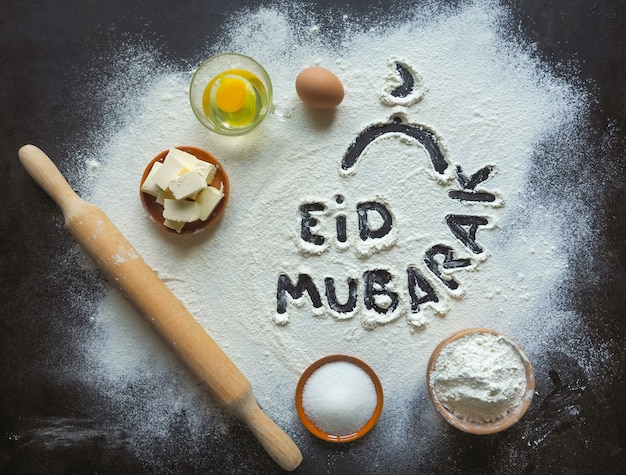 """Eid mubarak - fraza powitalna islamskiego święta """"wesołych świąt"""", pozdrowienia zastrzeżone. arabskie pieczenie."""