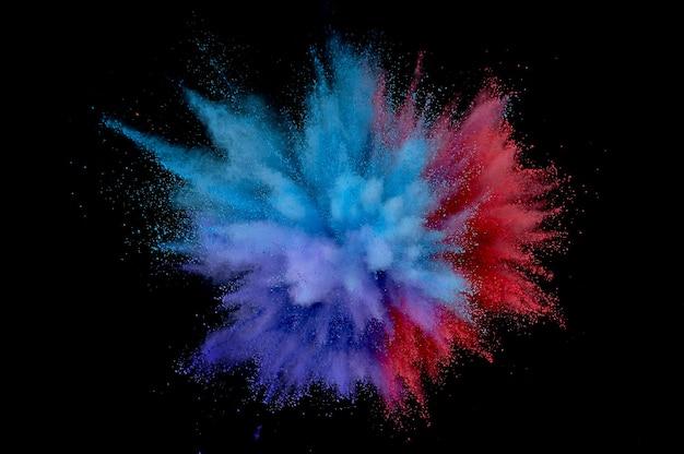 Eksplozja kolorowego proszku. streszczenie zbliżenie pyłu na tle. kolorowe eksplodować. maluj holi
