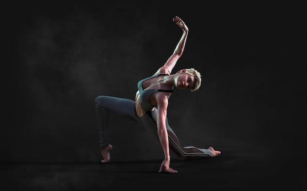 Elastyczna kobieta tańczy i pozuje w ciemności z dymem