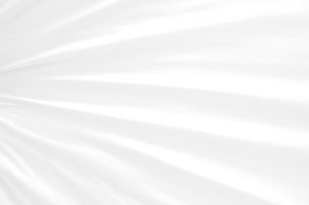 Elegancja fala abstrakcyjna miękka ostrość używana tkanina biała jako tło lub tapeta.