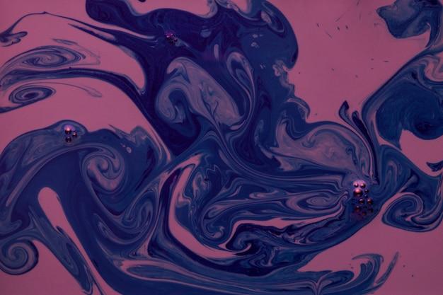 Elegancki marmurkowaty różowy i niebieski teksturowanej tło
