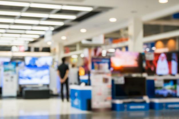 Elektroniczny dom towarowy pokaż telewizor i sprzęt agd z bokeh niewyraźne tło