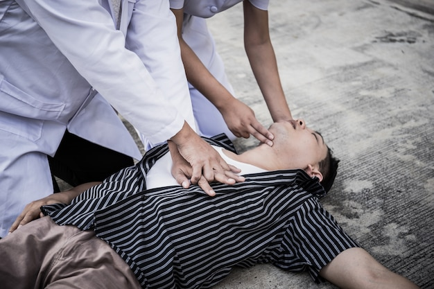 Emergency cpr on a man, nurse trying to process resuscitation (first aid)