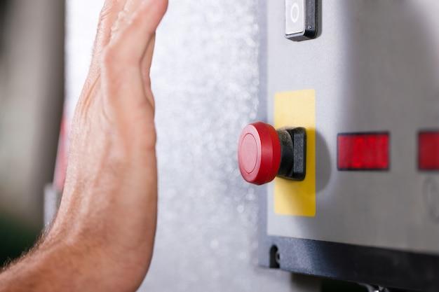 Emergency - man shutting machine of