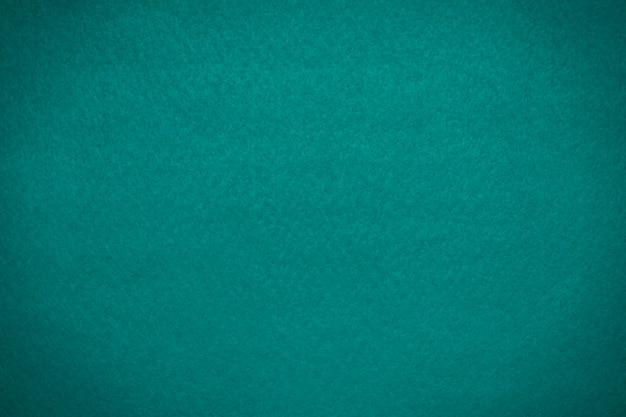 Fabryczna tekstura niebieskozielonego filcu bluevignette