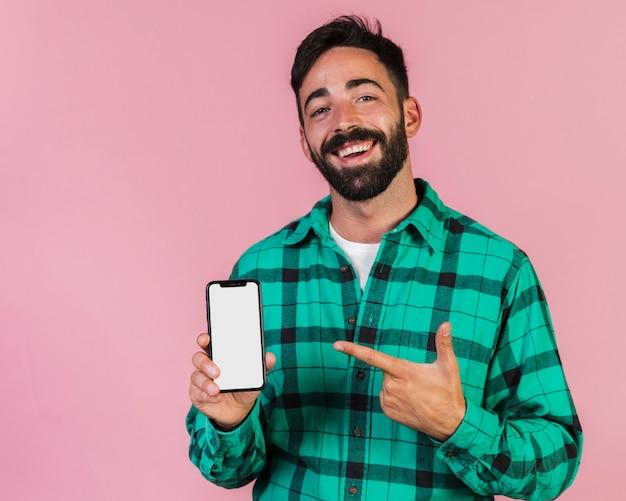 Facet z przodu widok wskazujący na telefon