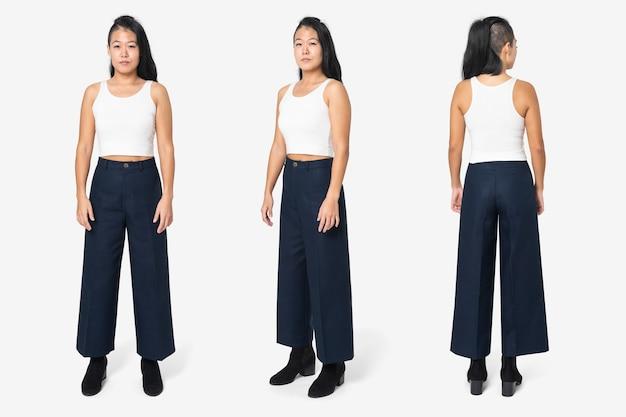 Fajna kobieta w białym podkoszulku i czarnych spodniach w kształcie litery a street fashion full body