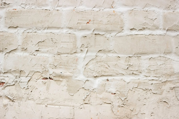 Faktura betonu z prześwitującą cegłą. tło