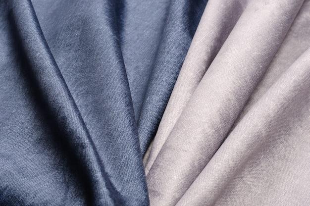 Faktura gładkiej tkaniny w kolorze aksamitnej szarości. streszczenie tło tkaniny
