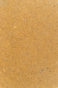 Faktura panelu wykonana z prasowanych wiórów. drewniane tło.