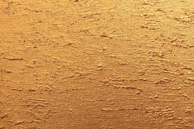 Fakturowana powierzchnia pomalowana złotą farbą