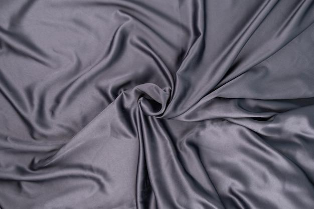 Falista, pomarszczona, szaro-niebieska fioletowa powierzchnia jedwabnej satyny