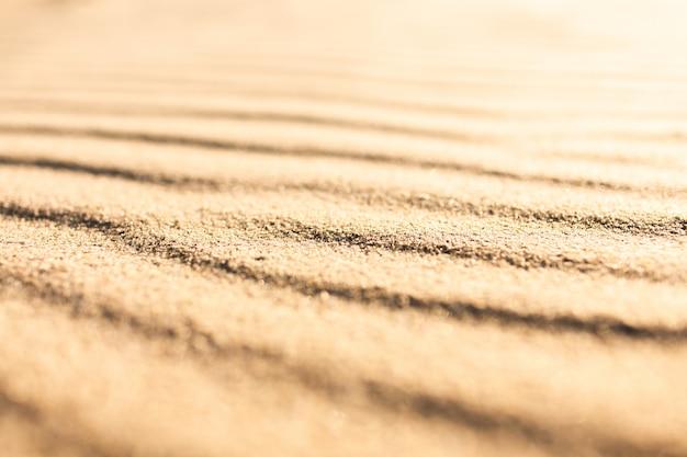 Falista tekstura piasku plaży czystego tła powierzchni