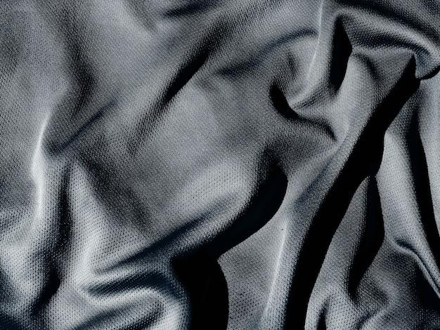 Falista tekstura tkaniny. czarny zbliżenie tekstury tkaniny