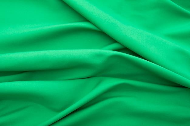 Falista zielona tkanina, tekstura tkaniny tkaniny lub tło