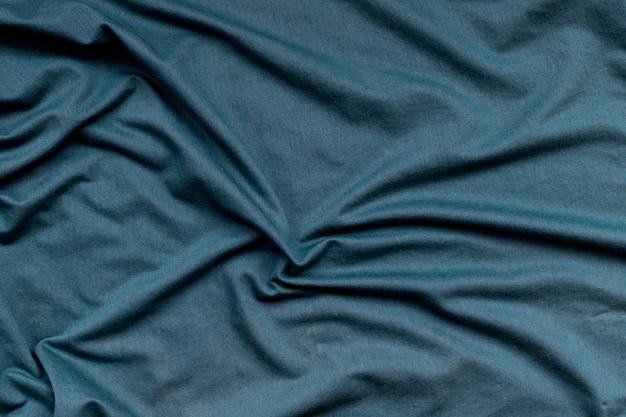 Falista zielonkawa tekstura tkaniny. abstrakcyjny