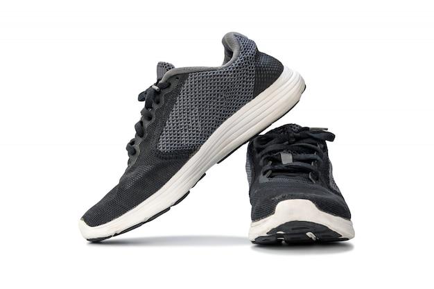 Fasonuje działających tenisówka buty odizolowywających na białym tle.