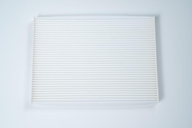 Filtr Powietrza Samochodu Na Białym Tle. Sklep Z Częściami Samochodowymi. Naprawy I Konserwacja Samochodów. Premium Zdjęcia