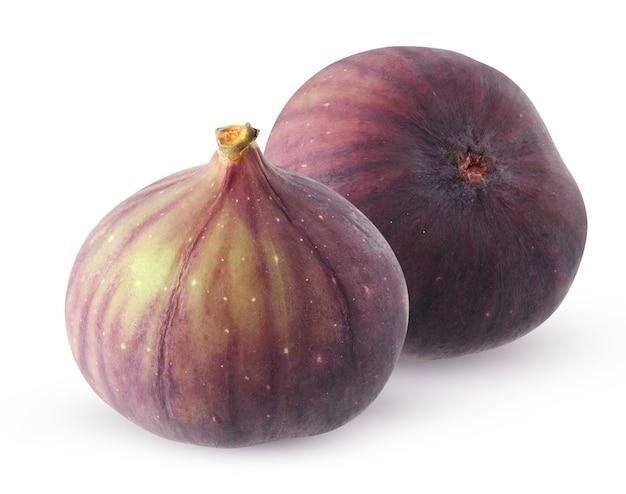 Fioletowe figi na białym tle na białej powierzchni ze ścieżką przycinającą. dwa całe owoce.