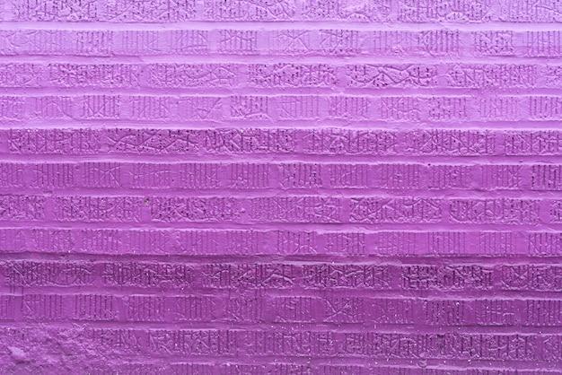 Fioletowy cegła na ścianie tło