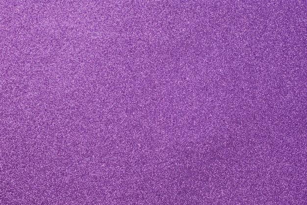 Fioletowy jasny błyszczący ziarnisty tło, brokat streszczenie tło